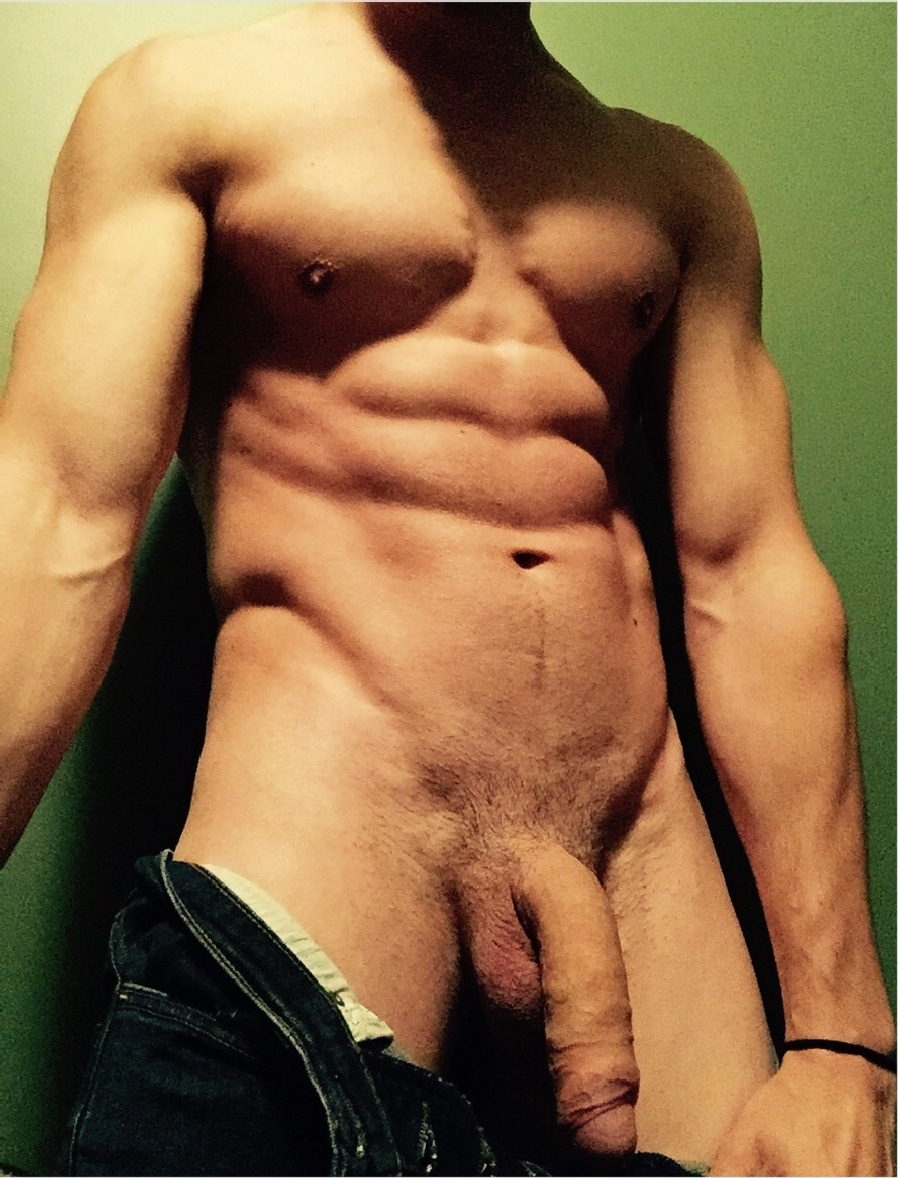 hunk showing off his big soft uncut cock with trimmed pubic hair
